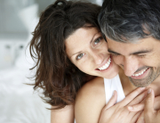 Closeup of romantic mature couple enjoying themselves on bed - Indoor